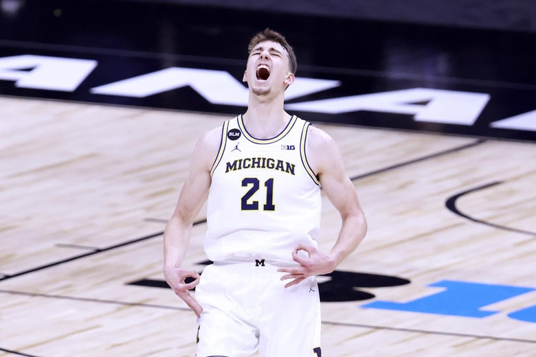 Franz Wagner of Michigan basketball yells in the air.