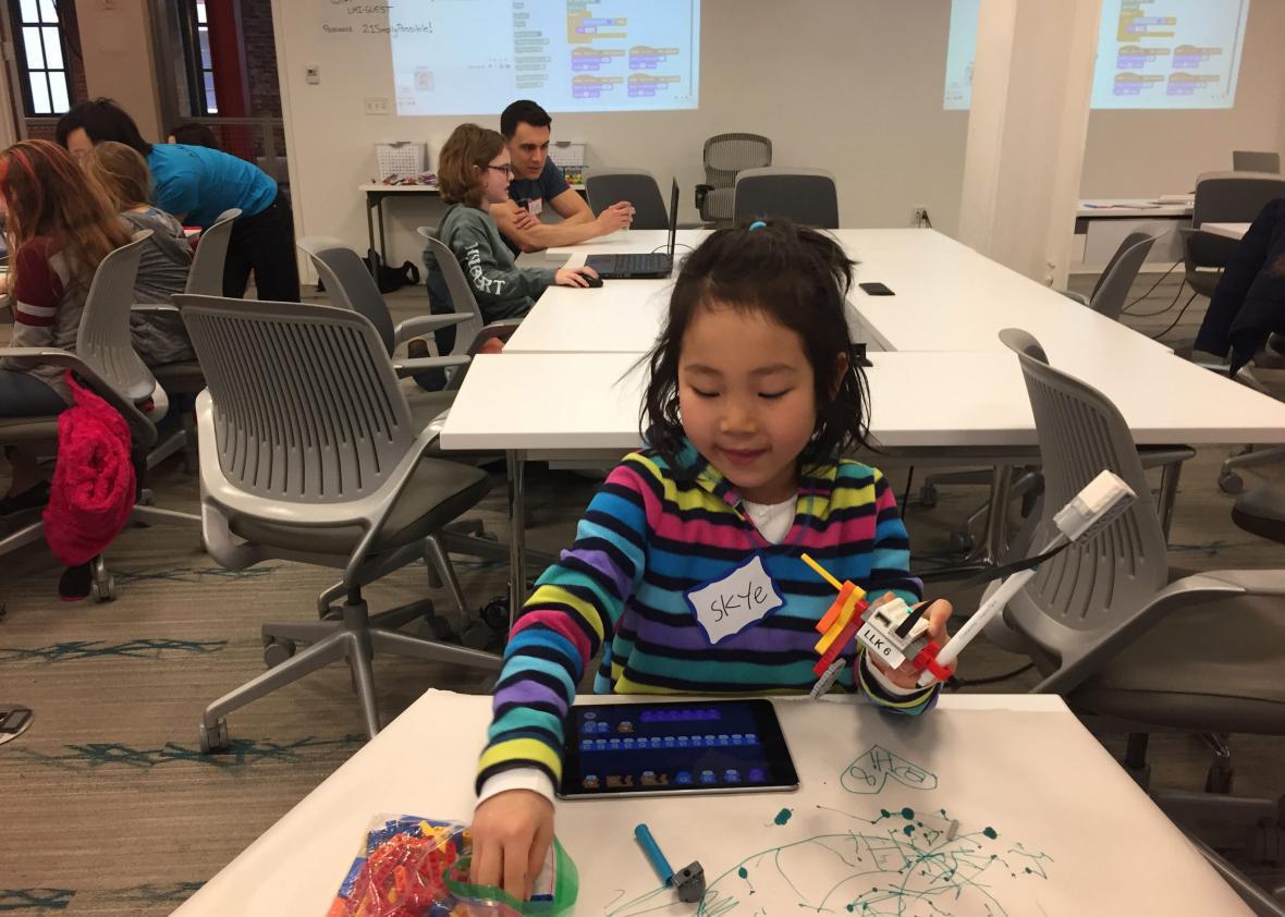 Skye Morishita working on the robot she programmed at a recent CoderDojo session in Boston. Photo: Chris Berdik
