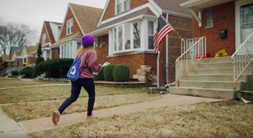 An anti-abortion canvasser campaigns for Democrat Dan Lipinski in Illinois.