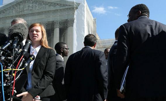 Plaintiff Abigail Noel Fisher (left) speaks to the media after the U.S. Supreme Court Supreme heard arguments.