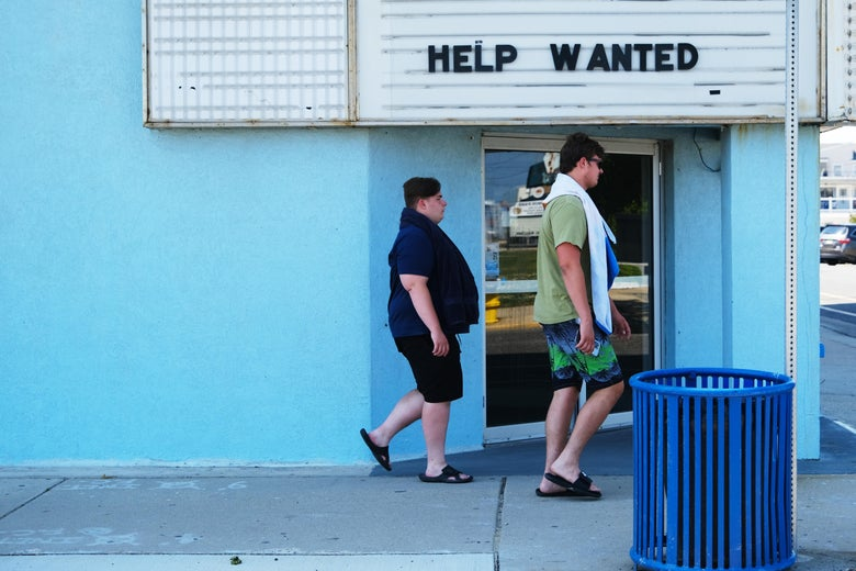 A help wanted sign is displayed outside of a business near the boardwalk days before the Memorial Day weekend, the unofficial start of summer, in the shore community of Wildwood on May 27, 2021 in Wildwood, New Jersey. Wildwood, like many beach communities throughout the United States, is looking for a successful and busy summer season after staying mostly closed or partially open last summer due to Covid-19 restrictions. Many resort community retail businesses are also suffering from a shortage of labor as some workers are choosing to stay home and others have changed career paths.  (Photo by Spencer Platt/Getty Images)
