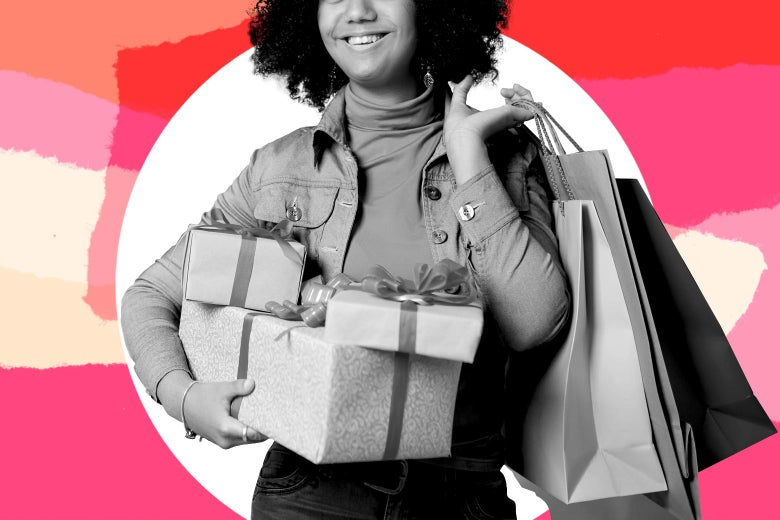 A smiling woman carrying a bunch of gifts.