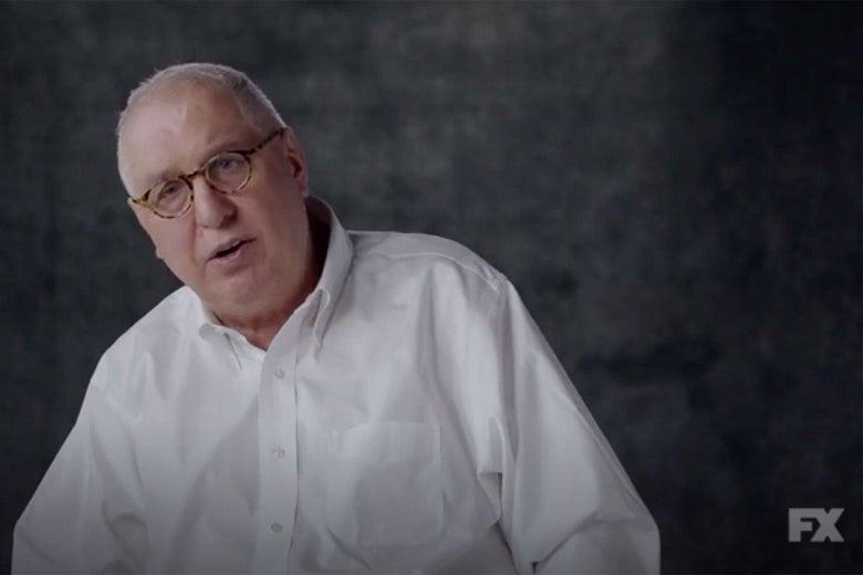 Errol Morris in a white button-down shirt against a gray background.