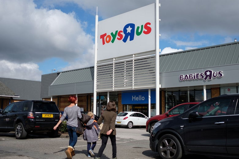 Customers walk toward a branch of the toy store Toys R Us on Tuesday in Luton, England.