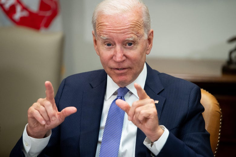Biden sitting in the Roosevelt Room of the White House pointing both index fingers as he speaks