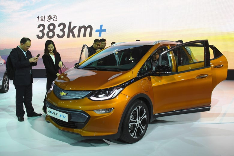 South Korean models pose with Chevrolet Bolt EV during a press preview of the Seoul Motor Show in Goyang, northwest of Seoul, on March 30, 2017.          South Korea's largest international auto show will open on March 31, with a total of 27 brands showing their latest cars and concepts.          / AFP PHOTO / JUNG Yeon-Je        (Photo credit should read JUNG YEON-JE/AFP/Getty Images)