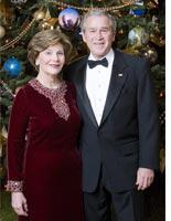 Laura and George Bush in front of the White House Christmas tree