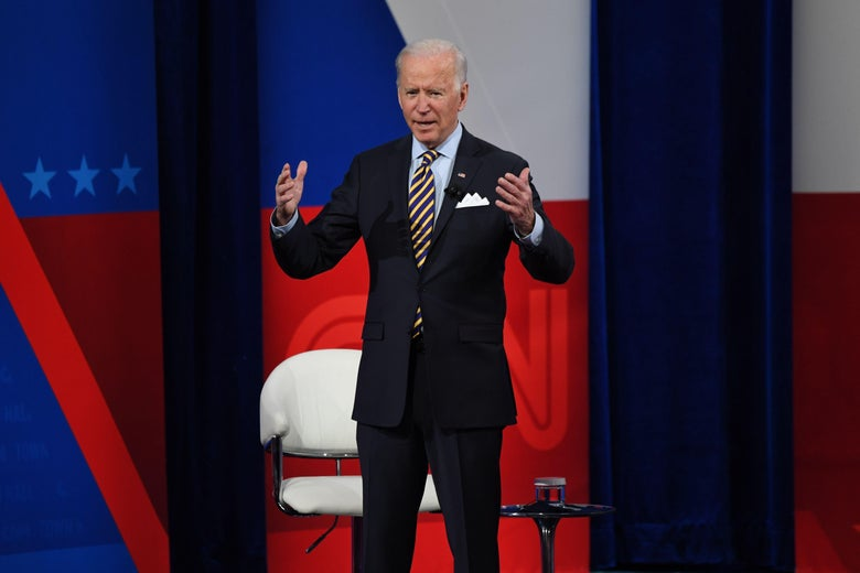 Biden raises both hands as speaks during the CNN town hall.
