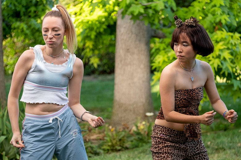 Anna Konkle and Maya Erskine as their younger selves in Pen15, dancing dressed as Spice Girls.