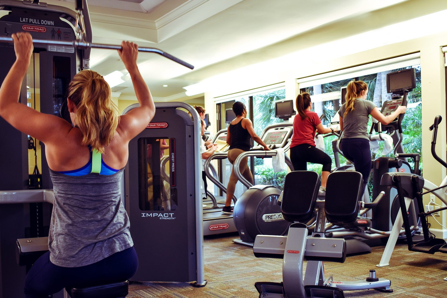 Employees of the Breakers work out in a fitness center.