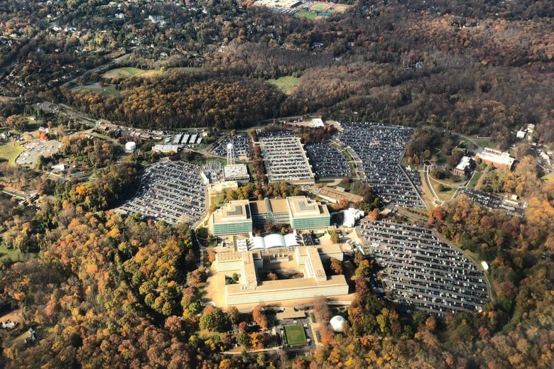 A thousand-foot bird's-eye view of CIA headquarters surrounded by fall foliage.
