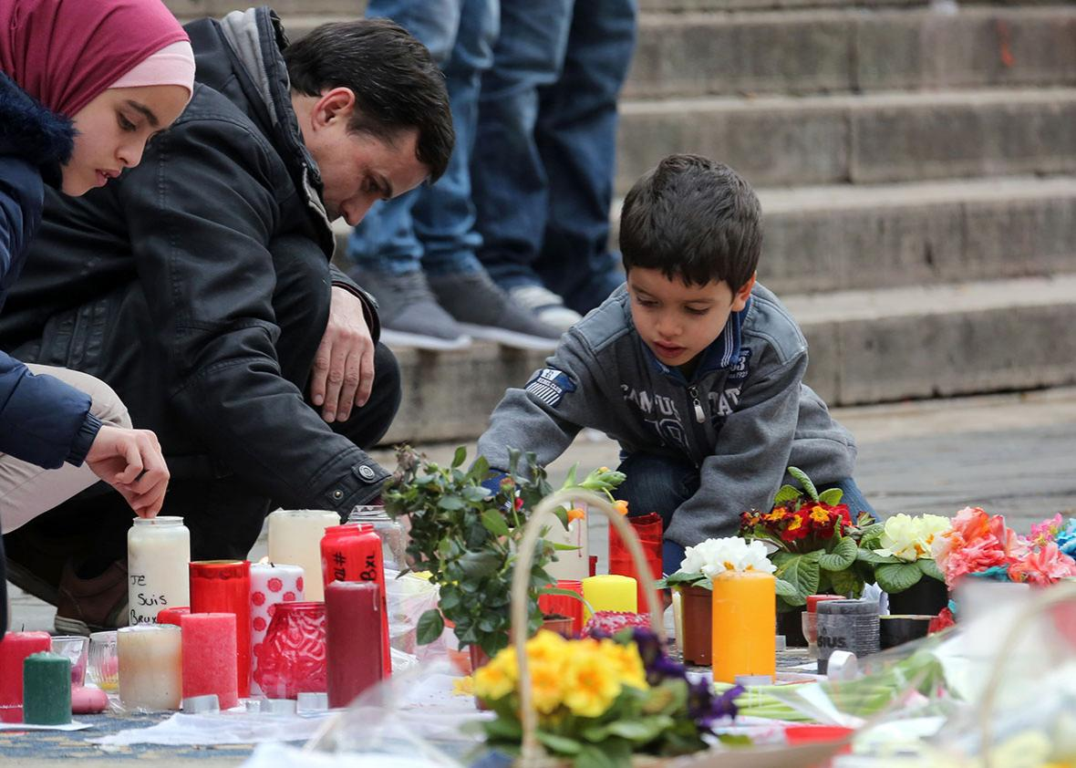 People gather in the Place de la Bourse in Brussels on Sunday to pay tribute to the victims of last week's attacks.