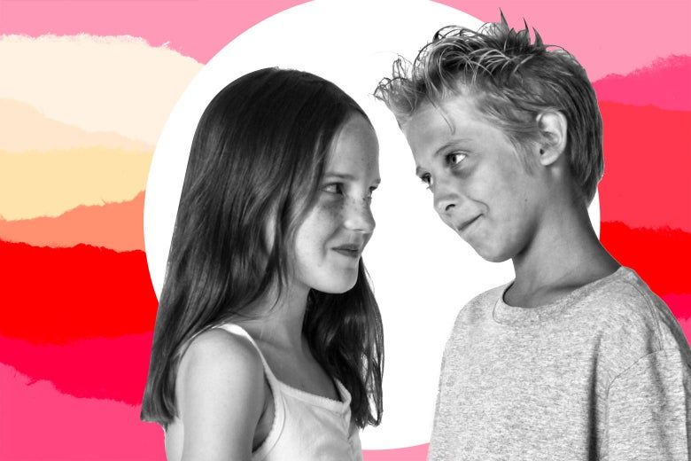 A young girl and a young boy face each other.
