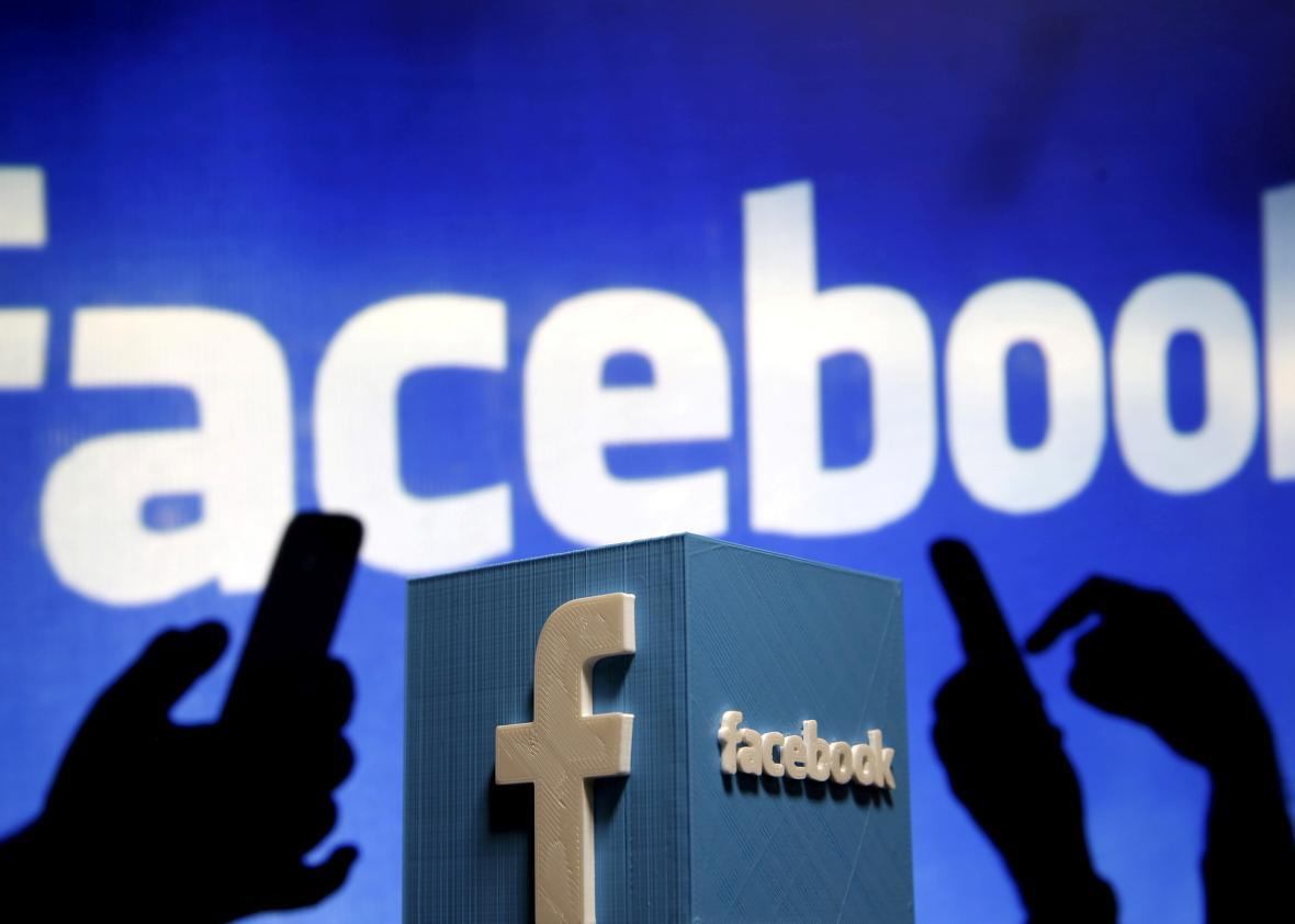 A 3D plastic representation of the Facebook logo is seen in this photo illustration May 13, 2015.
