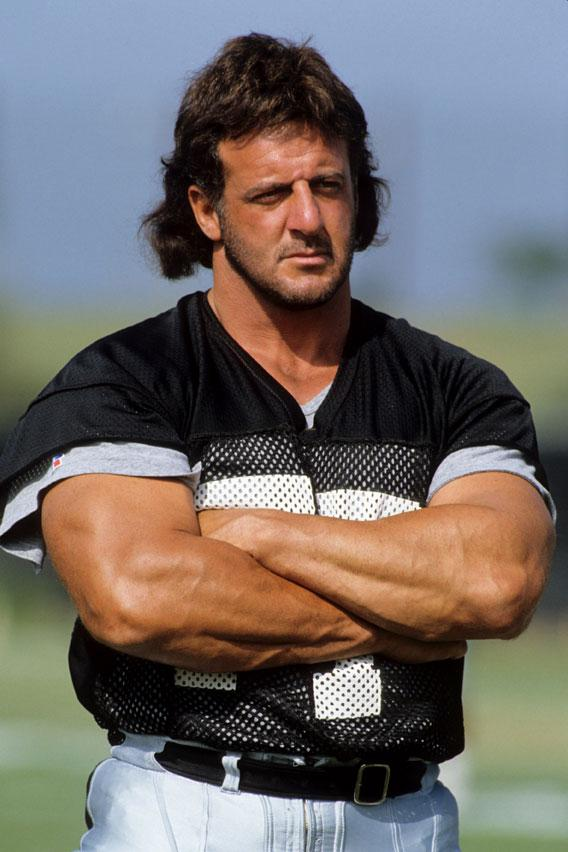 Lyle Alzado #77 of the Los Angeles Raiders looks on during August of 1990 training camp in Oxnard, California.