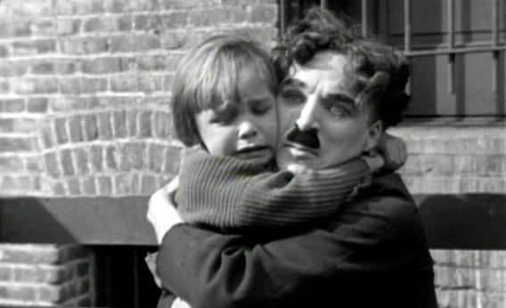 Charlie Chaplin and Jackie Coogan in The Kid.