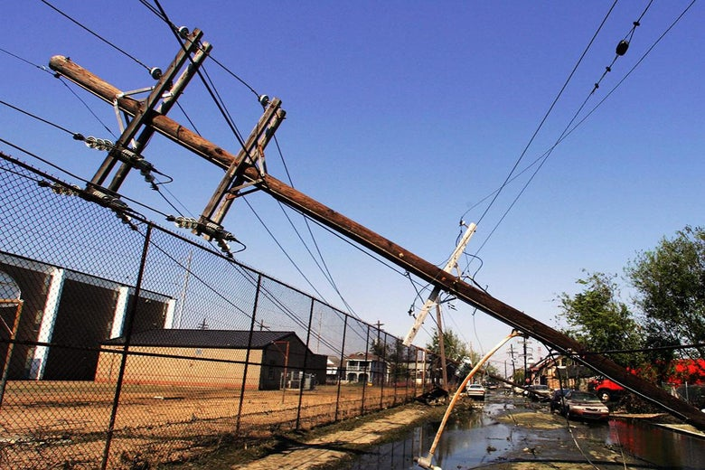 Downed telephone and power cable poles in the streets of New Orleans on Sept. 11, 2005.