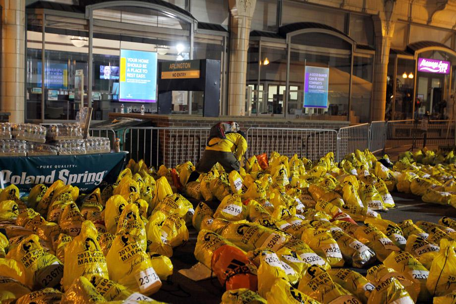 A runner looks through unclaimed runners' bags from the Boston Marathon in Boston, Massachusetts.