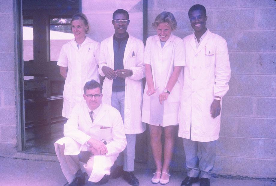 African-and-Western-doctors-posingA group of five doctors pose for the camera. These collaborations were highly regarded by the churches and aid organizations, and the African doctors had access to some of the best trained teachers and mentors in the world. In this shot, the real camaraderie between the doctors is on full display.