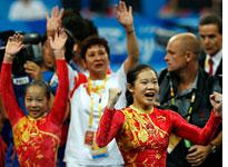 China celebrates its gold medal. Click image to expand.
