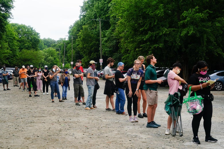 People wait in line to vote in Georgia's primary on June 9, 2020.