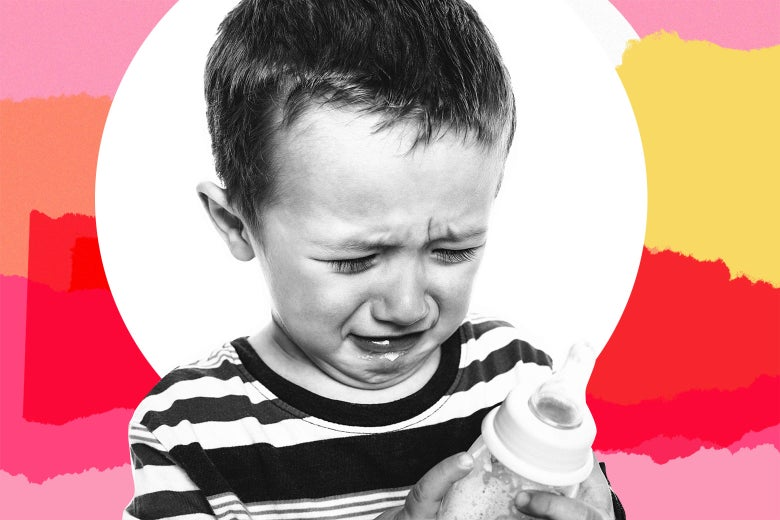 A crying preschooler holding an empty milk bottle.