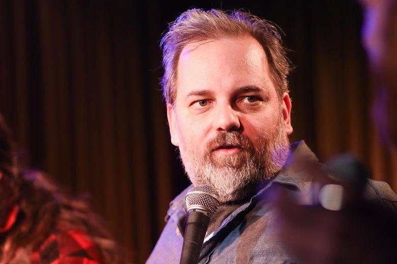 Dan Harmon, holding a microphone