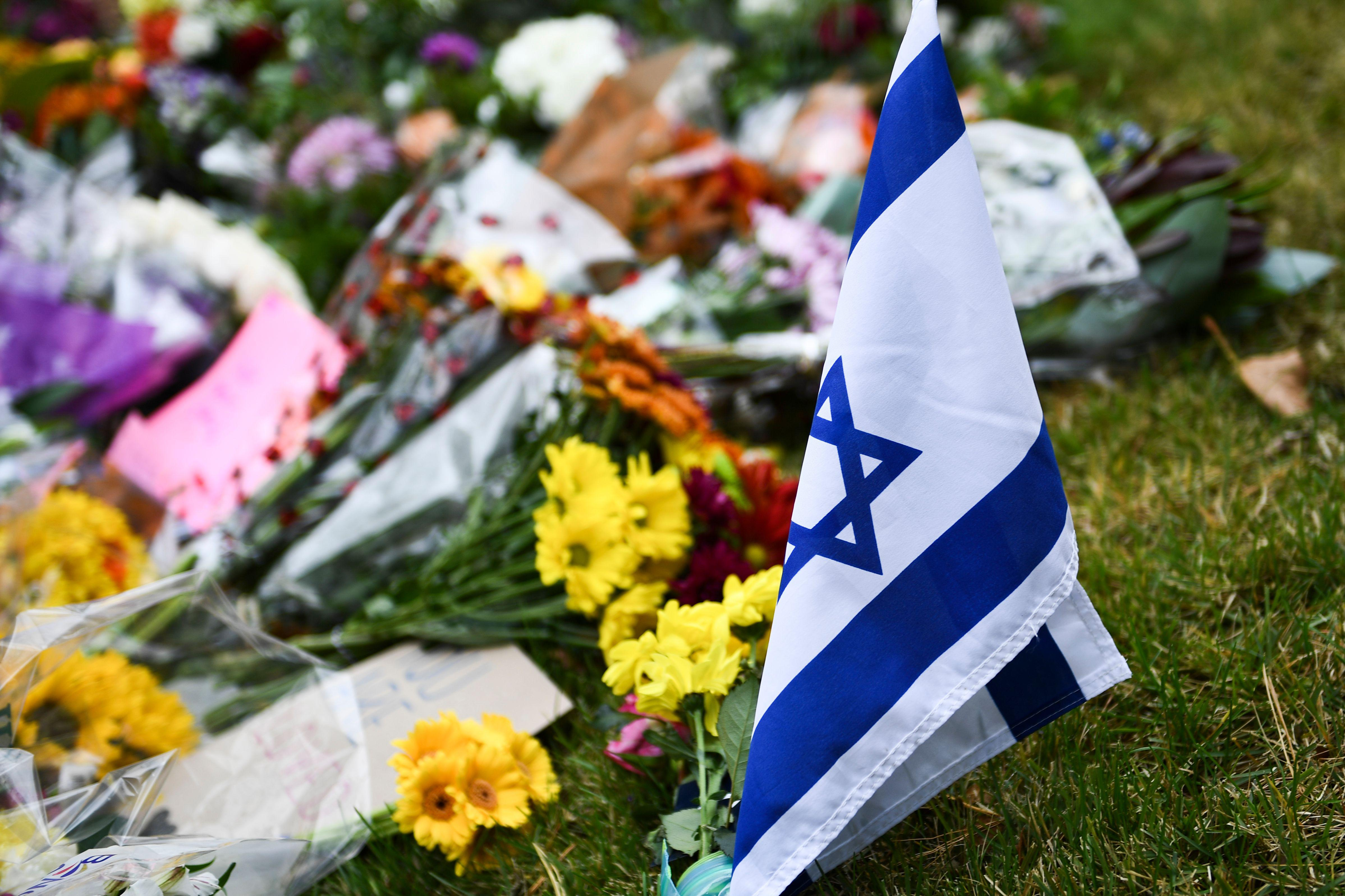 An Israeli national flag is seen at a memorial down the road from the Tree of Life synagogue.