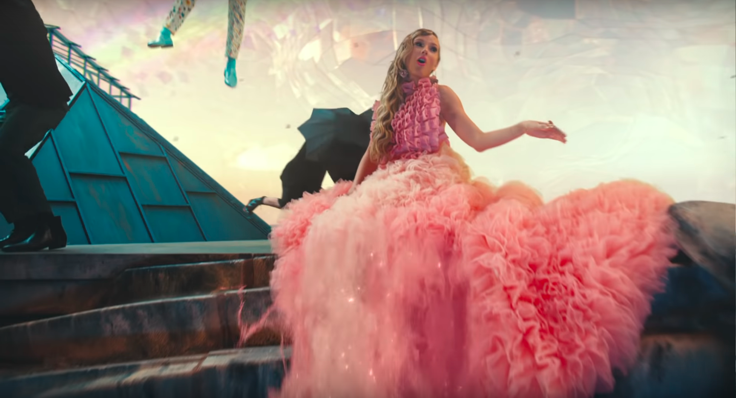 """A frilly, fluffy Taylor Swift in a pink dress in the video for """"ME!"""""""