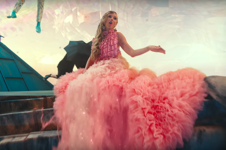 "A frilly, fluffy Taylor Swift in a pink dress in the video for ""ME!"""
