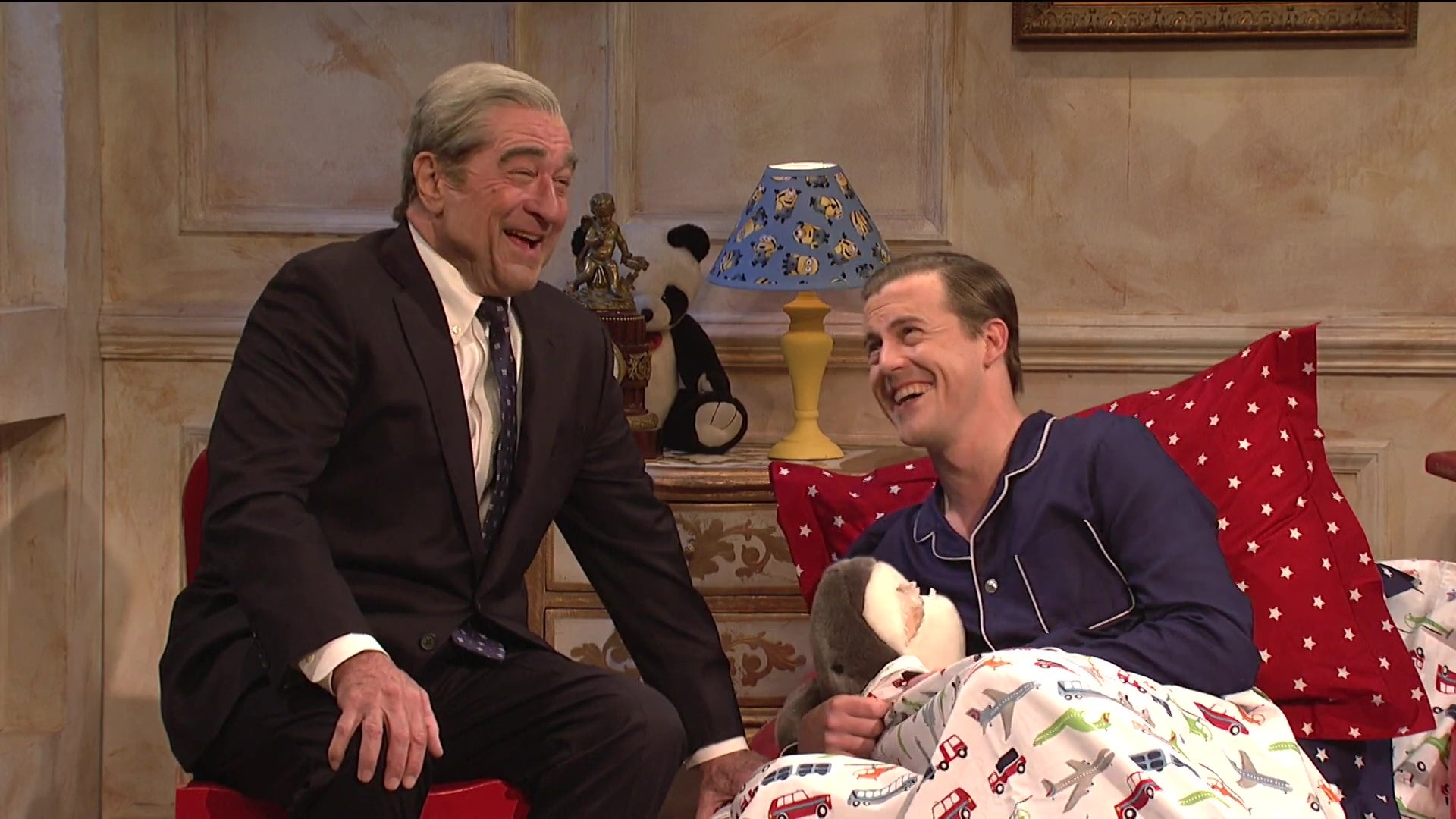 Robert De Niro and Alex Moffat laughing on Saturday Night Live.
