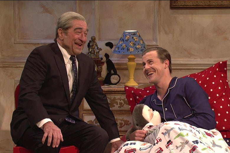 Robert De Niro and Alex Moffat laughing on Saturday Night Live.