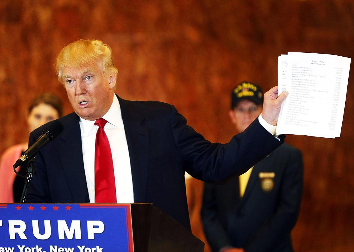 Republican presidential candidate Donald Trump holds a sheet of paper with his donations listed at a news conference at Trump Tower where he addressed issues about the money he pledged to donate to veterans  groups following a skipped a debate in January before the Iowa caucuses on May 31, 2016 in New York City.