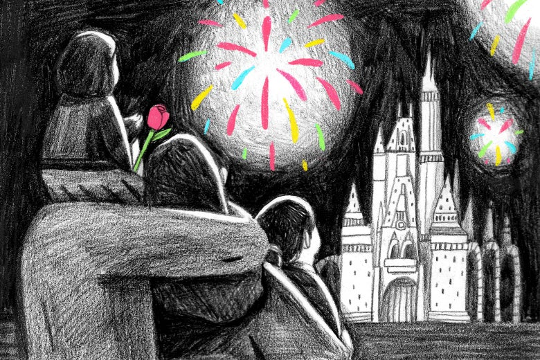 Mother, father, and two children holding a flower looking at fireworks over Cinderella Castle at Disney World.