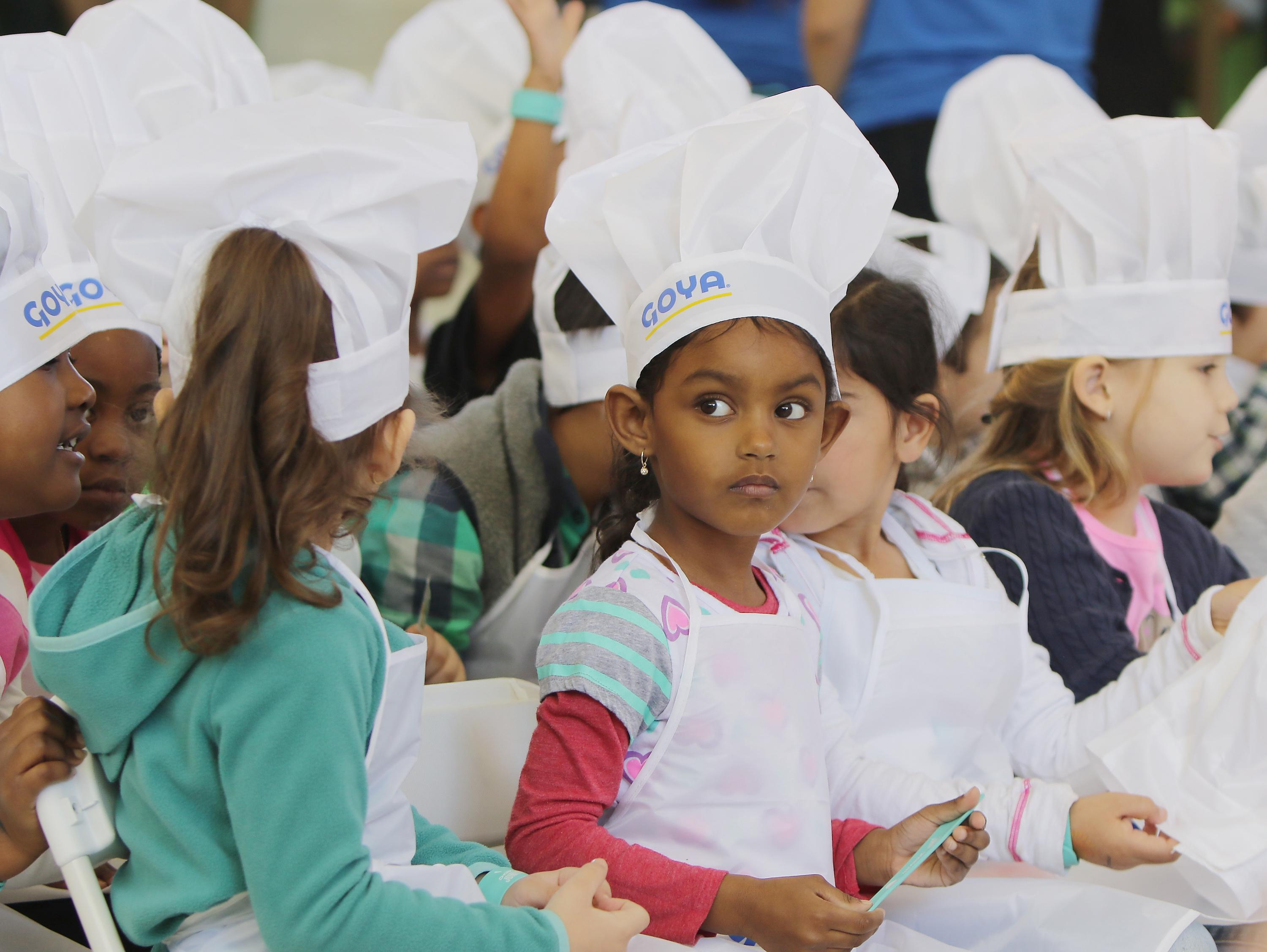 Children wearing chefs' hats.