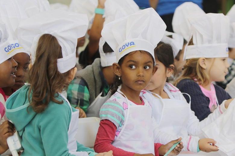 Children wearing chefs' hats.