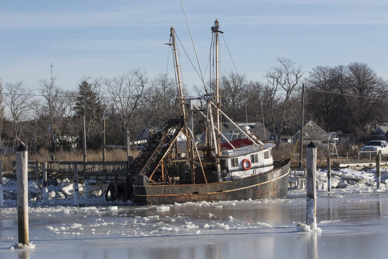 ORLEANS, MA - JANUARY 03:   Sea ice surrounds a boat in Rock Harbor on January 3, 2018 in Orleans, Massachusetts, A winter storm is hitting the east coast from Florida to New England bringing snow and frigid temperatures. (Photo by Scott Eisen/Getty Images)