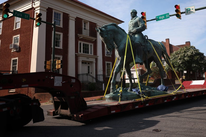 A flatbed truck carries a statue of Confederate General Robert E. Lee from the Market Street Park July 10, 2021 in Charlottesville, Virginia.