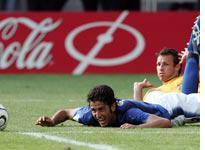 Italian defender Fabio Grosso falls. Click image to expand.
