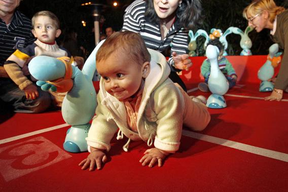 A baby sprints away before the start of a Christmas crawling race in Madrid December 13, 2007.