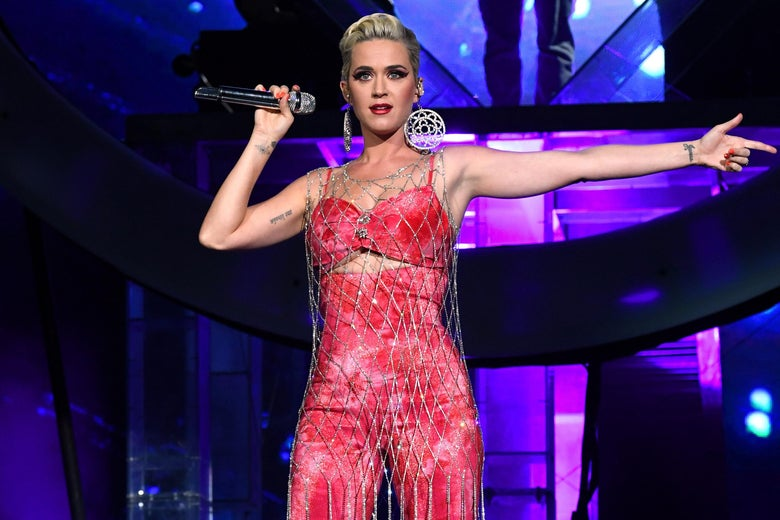 Katy Perry onstage holding a microphone.