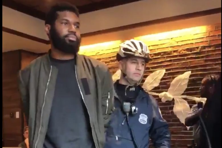 A screenshot from the video showing one of the two men being arrested in a Philadelphia Starbucks
