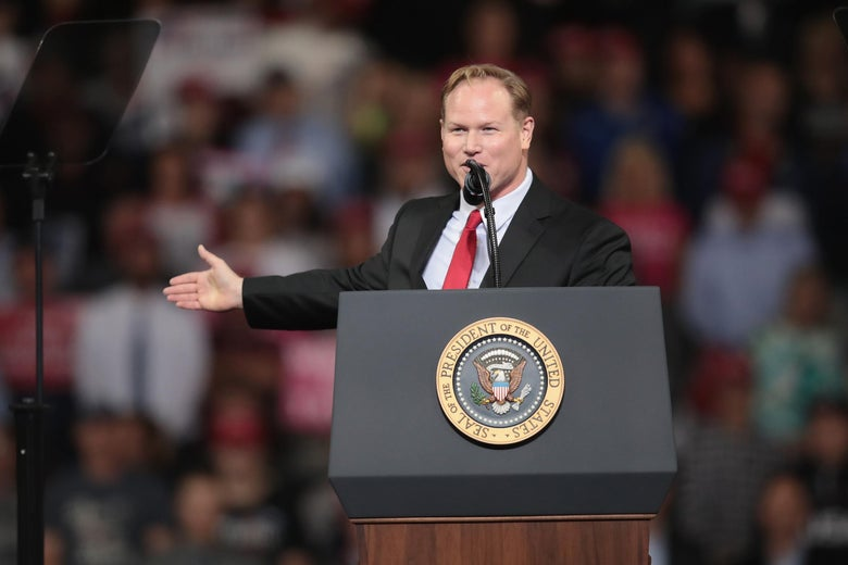 Then-candidate Steve Watkins speaks at a Trump rally in Oct. 2018.