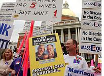 Proponents of gay marriage hold signs. Click image to expand.