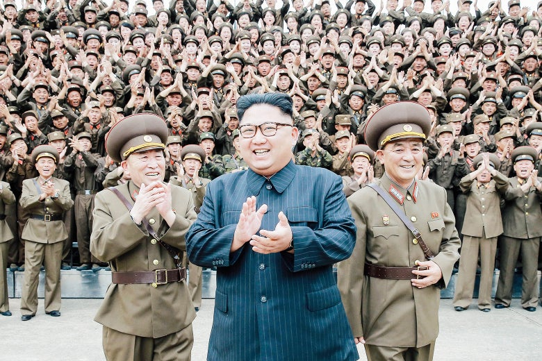 North Korean leader Kim Jong-un claps with military officers at the Strategic Force Command of the Korean People's Army in an unknown location in North Korea in this undated photo released by the Korean Central News Agency on August 15.