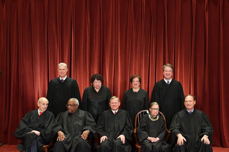 Stephen Breyer, Clarence Thomas, John Roberts, Ruth Bader Ginsburg, Samuel Alito, Neil Gorsuch, Sonia Sotomayor, Elena Kagan, and Brett Kavanaugh seated in their robes.