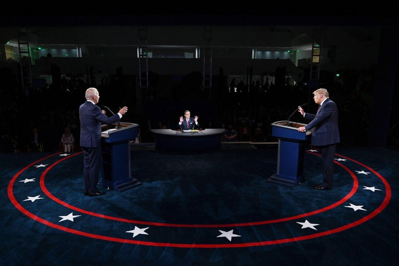 Trump and Biden gesture from opposing lecterns at the first presidential debate.