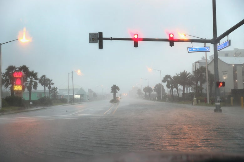 Water floods a road as the outer bands of Hurricane Sally come ashore  in Gulf Shores, Alabama.