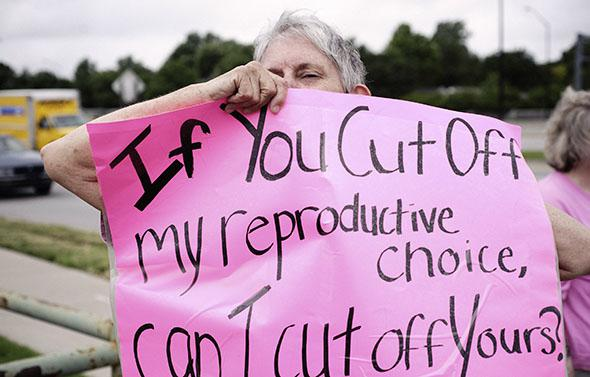 A pro-choice supporter demonstrates in front of the clinic of Dr. George Tiller, who was killed by anti-abortion activist, in Wichita, Kansas, in June 2009.