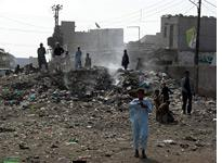 A trash fire in the Machar Colony slum         Click image to expand.